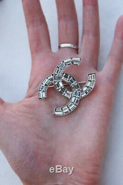 2004 CHANEL Silver plated CC brooch with rhinestones