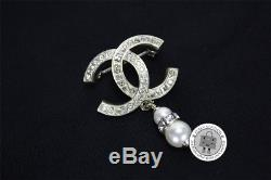 Auth New Chanel CC Crystal Dangling Pearl Gold Metal Brooch