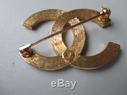 Authentic CHANEL CC Gold-tone Logo Pin Brooch 1.5 x 1 inches