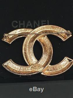 Authentic Chanel CC Logo Brooch With Baguette Crystals