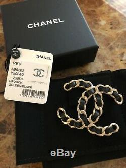 Authentic Chanel large black leather and gold metal woven CC brooch