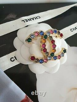 Brand new Chanel CC brooch with color stone