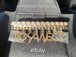 Chanel Gold Chanel CC Logo White Crystals Charms Brooch Pin