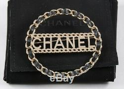 NWT Authentic Chanel 18K Leather Circle Brooch Logo Black Gold