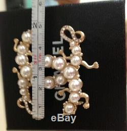 Rare Chanel mint condition gold pearls brooch pin box bag